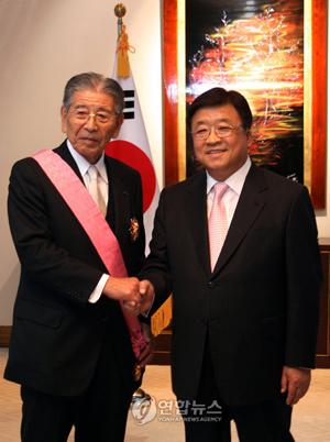 電通会長の成田豊