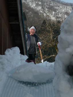 雪かきのおばちゃん