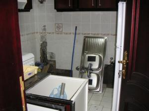 Doha Apartment room mess kitchen 2