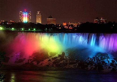 Niagara Falls lit up with the colors of the rainbow