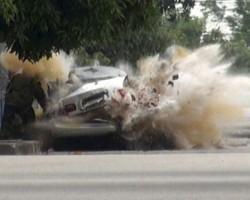 Car blown sky high as bomb disposal officer investigates