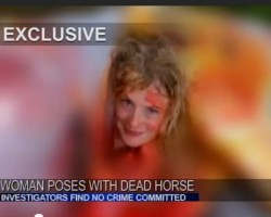 Woman Poses Naked Inside Dead Hors